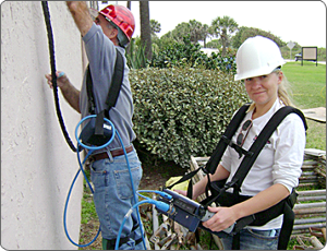 Two workers inspect a wall with GPR equipment